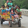 KULIGLIG. A hand tractor becomes more than just a tractor operated with the hand, but a rural transport as well. Called 'kuliglig' by the Tagalogs because of the sound it emits, hand tractors have for so long evolved into this vehicle that are at times as gaily painted as jeepneys. This was sighted along Kabacan road. (King Rodriguez)