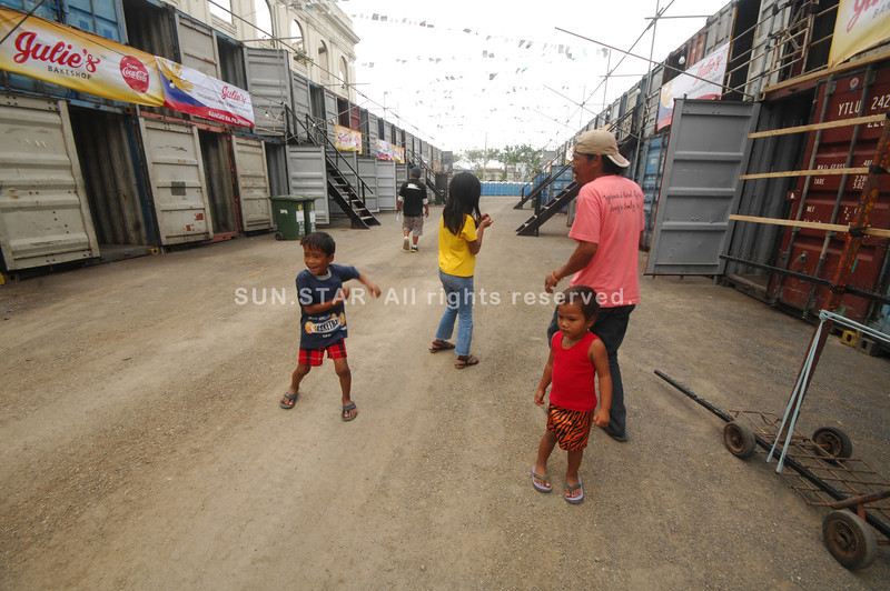 DANCING CITY. A handful of devotees dance the Sinulog while checking their temporary shelter made of container vans that the city prepared for them for the Sinulog festivities. (Sun.Star Photo/Alex Badayos)