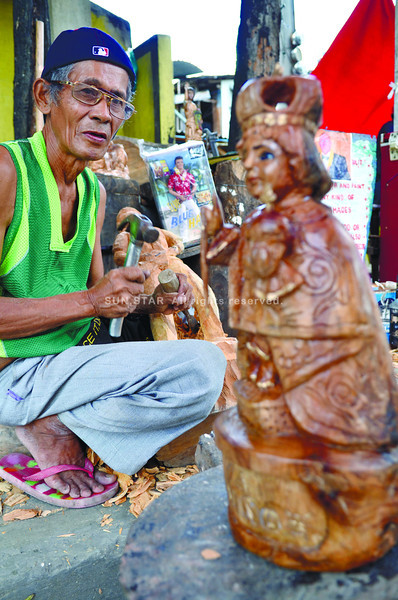ROADSIDE OFFERING. Tony Febroa's skill in woodcarving, developed over nearly 40 years, makes him a favorite among collectors of images of the Señor Sto. Niño. (Sun.Star Photo/Amper Campana)
