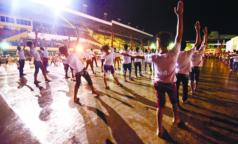 For most Sinulog performers, the holiday season passed in a whirl of rehearsals. As the parade draws closer, practice sessions now stretch after dark on the stage in the Cebu City Sports Center. (Photo by Alex Badayos of Sun.Star Cebu)