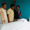ZAMBOANGA. Armm Gov. Mujiv Hataman (center), accompanied by Basilan Bishop Martin Jumoad, visited and distributed cash aid on Thursday to the relatives of slain ambush victims. (Bong Garcia)