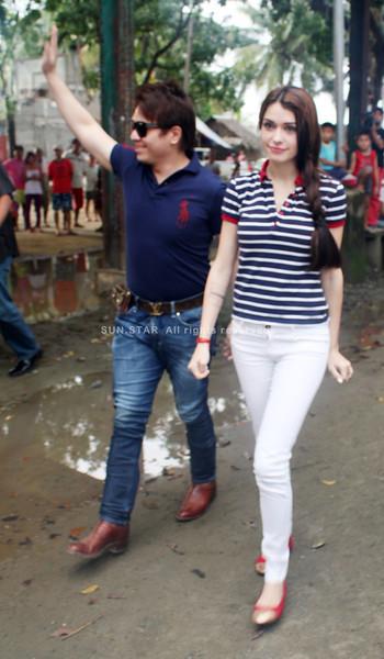 CAGAYAN de Oro Representative Benjo Benaldo with actress Daiana Menezes during an activity in Barangay Bonbon last Saturday. (Joey P. Nacalaban)