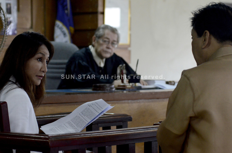 CEBU. Gov. Gwendolyn Garcia (left) tells the court, presided by Judge Raphael Yrastorza Sr. (foreground), that she is Doling Kawatan, a character depicted in broadcaster-columnist Leo Lastimosa's column in 2007. The governor is under cross examination by Lastimosa's lawyer Celso Espinosa, in relation to the libel case she filed against the columnist. (Sun.Star Photo/Amper Campana)