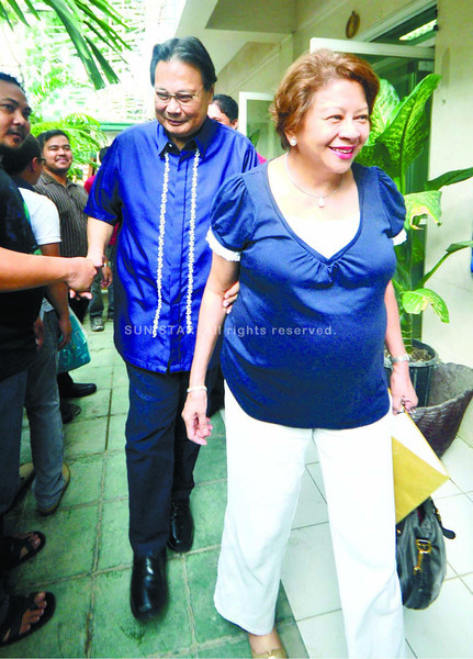 CEBU. Former Chief Justice Renato Corona and his wife Cristina leave the CCTN studio in Cebu City after the taping of his interview with a talk show.  (Alex Badayos)