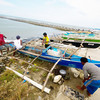 SAFETY FIRST. Fishermen from Talisay City bring their pumpboats to safer ground at the South Road Properties, as they take refuge from the strong waves brought by the southwest monsoon and Typhoon Gener. (Sun.Star Cebu photo/Alex Badayos)