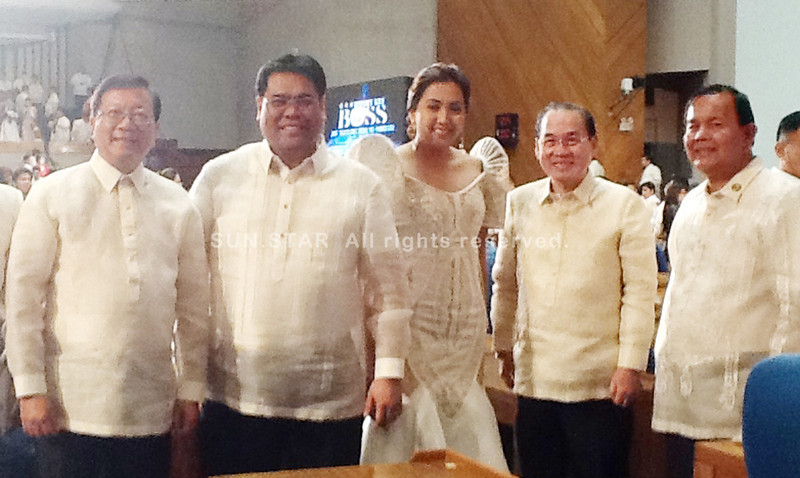 BACOLOD. Fourth district Representative Jeffrey Ferrer (2nd from L), 6th district Representative Mercedes Alvarez (C) and 5th district Representative Alejandro Mirasol (R) pose with their colleagues after the Sona. (Carla N. Cañet)