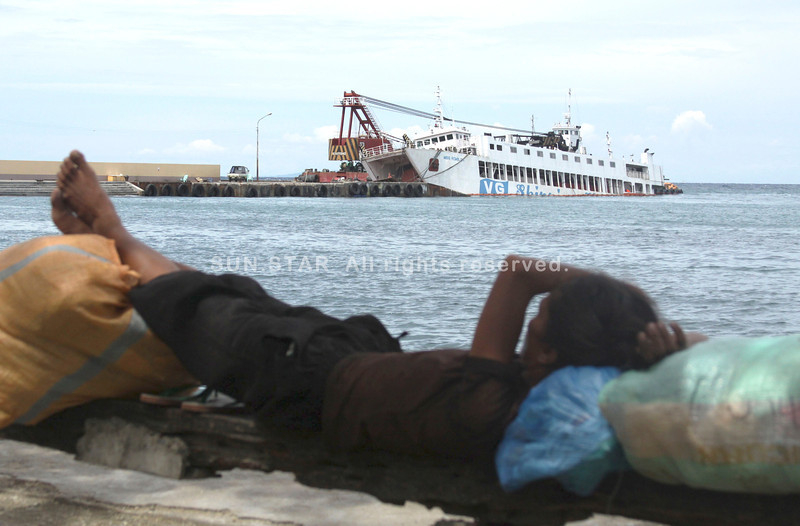 CEBU. A passenger and cargo ship bound for Camotes, the M/V Miss Romblon, which is docked at the Danao port, tilted amid big waves last Monday night. It has taken in water since then. (Alex Badayos)