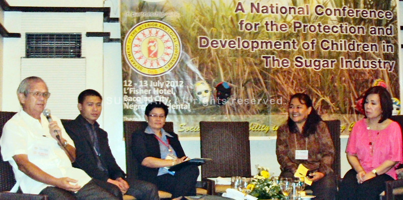 "BACOLOD. Jaime G. Golez (L), NFSP vice president for Western Visayas, explains how NFSP provides farm workers' dependents with education and skills training during the Thursday opening of the national conference on the welfare of ""children of the canes."" (Butch S. Bacaoco)"