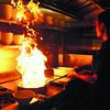 Phat Pho Restaurant's Chef Hoang Lee fires it up. (Ruel Rosello photo/Sun.Star Cebu)