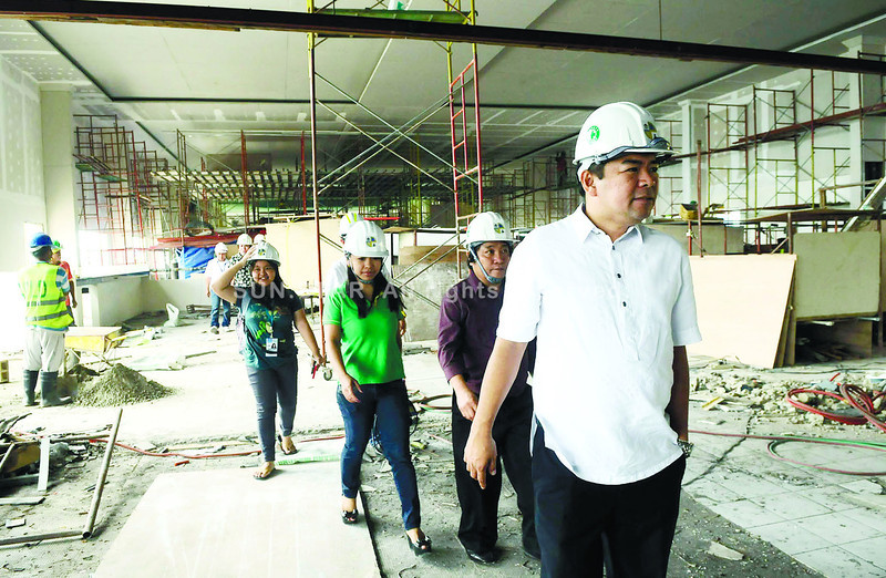 Cebu Port Authority Deputy General Manager Yusoph Uckung (right) leads members of media in a tour of the Pier 1 renovation project. (Arni Aclao photo/Sun.Star Cebu)
