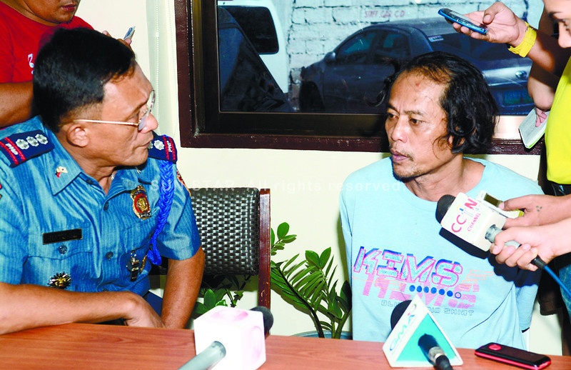 Benidicto Lambino talk to Cebu City Police chief Natuil after he arrested at Toledo City of killing Jeseyla Muñuz at sitio sto. Nino Quiot Cebu City.<br /> <br /> ssd foto/allan defensor