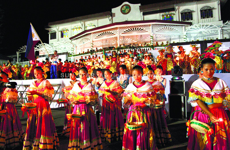 Contingents from 15 barangays in Carcar City light candles as part of a festival for the city's sixth Charter Day celebration. However, a power interruption and heavy rain reportedly compelled organizers to cut short the dance ritual presentation. (Alex Badayos photo/Sun.Star Cebu)