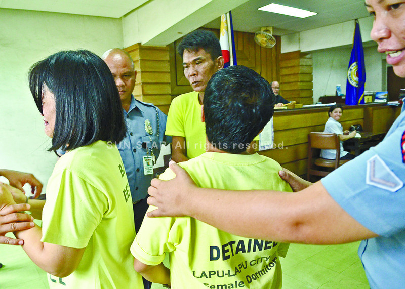 Regional Trial Court Judge Simeon Dumdum Jr. (right, background) convicted Valentino Martin (center, back row) of human trafficking but acquitted co-accused Loida Santos Valencia (right) and Shiela Santos Valencia (left). (Amper Campaña photo/Sun.Star Cebu)