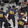 CAGAYAN DE ORO. Police search for evidence at the blast site outside Kyla's Bistro at the Rosario Arcade in Lim Ket Kai Complex on Friday night after an explosion believed to be from an improvised bomb killed six people and wounded dozens others. (Bobby Lagsa/Sun.Star Cagayan de Oro)