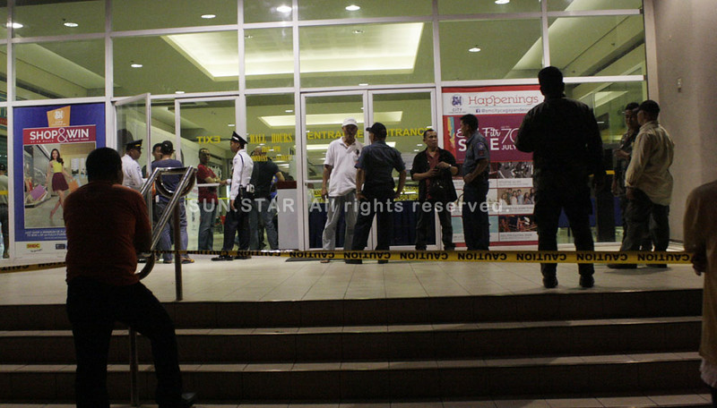 CAGAYAN DE ORO. This is the first time the city experiences a mall being robbed. The entrance where two men appear, tell the guards to drop and fire shots to create chaos in a five-minute heist. The robbers cart away jewelry from a shop inside the mall on Tuesday evening, July 22, 2014. (PHOTO BY JOEY P. NACALABAN)