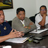 CAGAYAN DE ORO. City Police Director Graciano Mijares answers questions from the media during a press conference held at the Mayor's Office yesterday, July 23, 2014. On his right is City Administrator Roy Raagas and City Councilor Rodolfo Lao. (Joey P. Nacalaban)