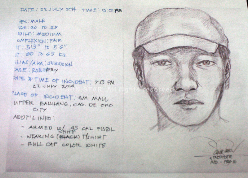 CAGAYAN DE ORO. City police director Sr/Supt. Graciano Mijares shows the artist sketch of one of the suspects during the media briefing at the Mayor's Office on July 23, 2014. (Joey P. Nacalaban)