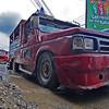 Jeepney on muddy street