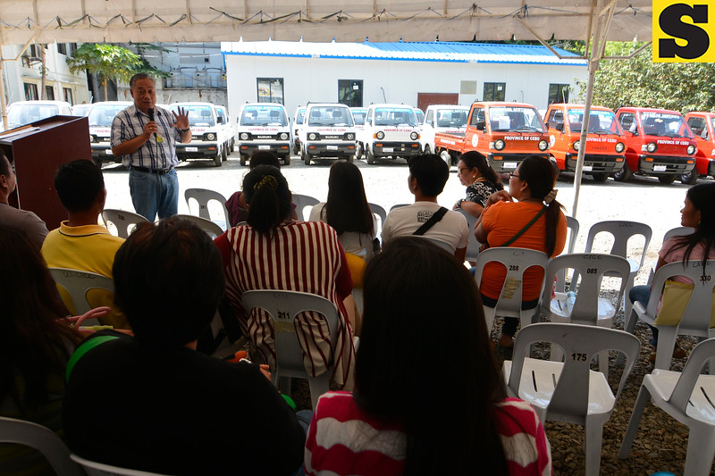 Governor Hilario Davide with multi-cab beneficiaries