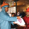 Baguio mayor Mauricio Domogan gives relief goods to typhoon victims
