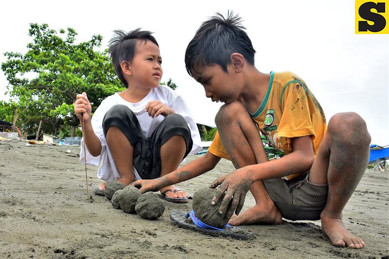 Kids playing at sea shore