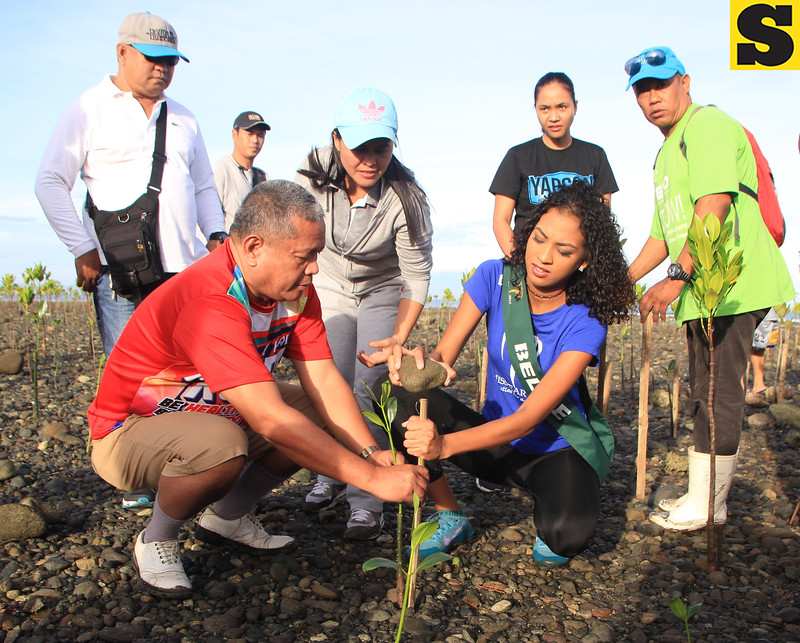 Miss Earth candidate plants mangrove tree