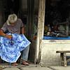 Man repairs umbrella