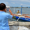 Fisherman taken photo with his boat