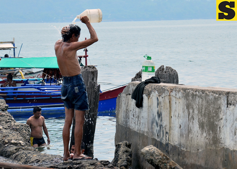 Man bathes at Sta, Ana Pier