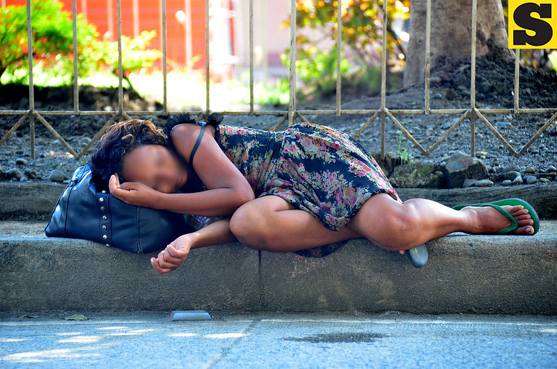 Woman sleeps on the streets