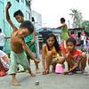 Kids playing Pogs