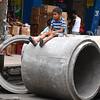 Boy sits on cement culvert