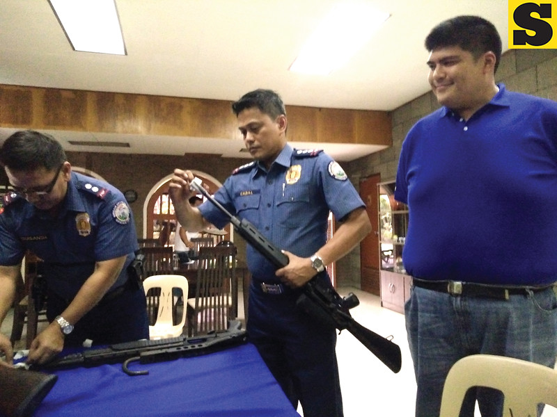 Firearms turned over to police with Luigi Quisumbing around