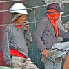 Construction worker smokes cigarette