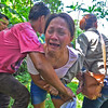 Woman cries for death of husband