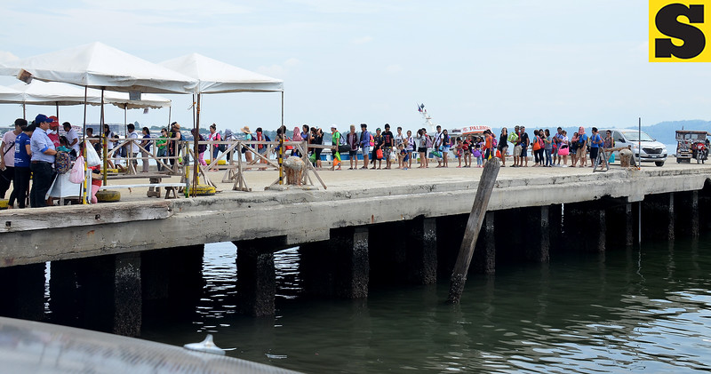 Passengers bound for Samal underwent security check