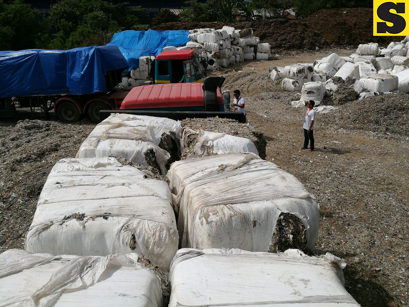 Packs of garbage allegedly shipped from Korea