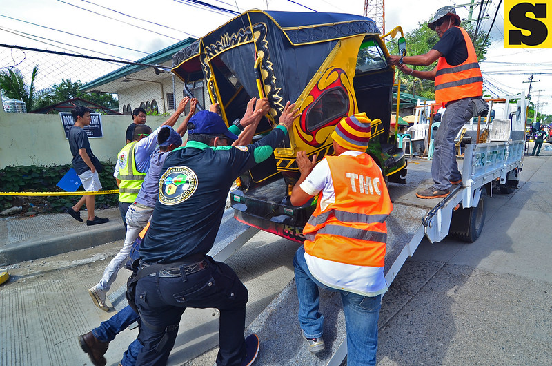 Traffic enforcers tow tricycle