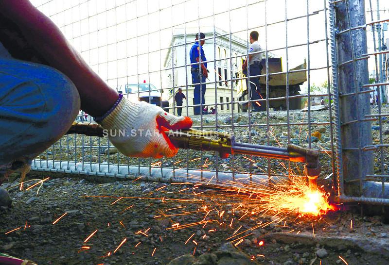 Demolition team takes down concrete fence
