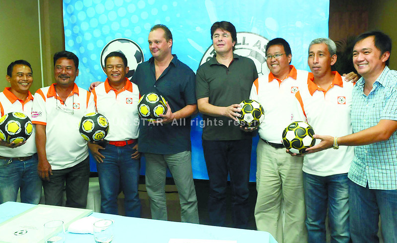 BENEFICIARIES. Philippine Azkals head coach Michael Weiss (4th from left) and Roland Bischof of Deutsher Fussball Botschafter (4th from right) with CFA board members at the Casino Español de Cebu. (Arni Aclao of Sun.Star Cebu)