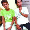 CAUGHT. Two men are handcuffed after they were caught as suspects in the abduction of a 16-year-old college student. (Davinci S. Maru photo/Sun.Star Cebu)