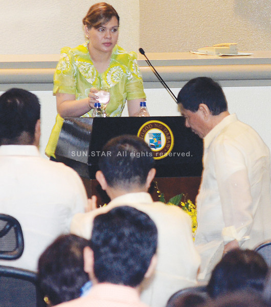DAVAO. Kibitzers were abuzz when not a word or handshake was exchanged between Davao City Mayor Sara Duterte-Carpio and father Vice Mayor Rodrigo Duterte before and after the mayor's State of the City Address. (King Rodriguez)