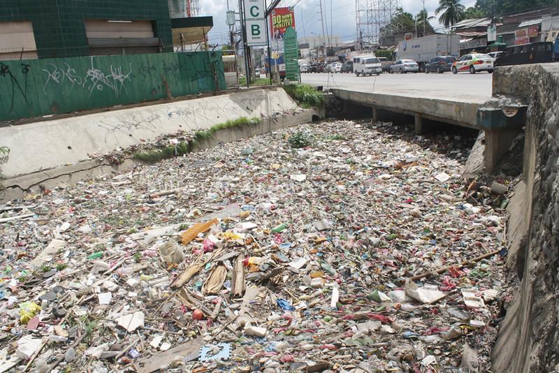 CAGAYAN DE ORO. This heap of garbage clogs Bitan-ag creek, a waterway that cuts across a mall, a state university and drains toward the shores bordering barangays Macabalan and Lapasan. (Joey P. Nacalaban)