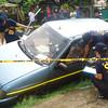 ZAMBOANGA CITY. A police photo handout shows Scene of the Crime Operatives (Soco) inspecting the vehicle of NFA employee Sultan Radzak Bago, who survives an ambush Tuesday in Pagadian City. (Bong Garcia)