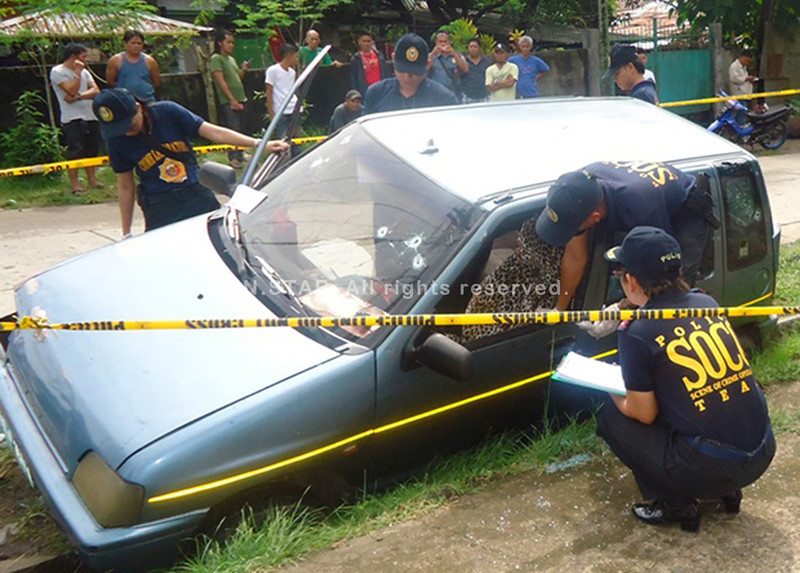 ZAMBOANGA CITY. A police photo handout shows Scene of the Crime Operatives (Soco) inspecting the vehicle of NFA employee Sultan Radzak Bago, who survives an ambush Tuesday in Pagadian City. (Bong Garcia)