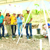 REBUILDING TOGETHER. At the launch of a relocation project in San Remigio, offi cials drop a time capsule. They are (from left) Hilfswerk Austria Project<br /> Manager Susanne Chylik; Mano, San Remigio Barangay Captain Eleazar Mahinay; Austrian Honorary Consul Julie Alegrado-Vergara; Hilfswerk Austria<br /> Managing Director Heidi Burkhart; Marge Gravador of Ramon Aboitiz Foundation Inc.; and San Remigio Mayor Mariano Martinez. (SUN.STAR FOTO/ALLAN CUIZON)