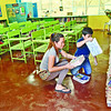 BY THE BOOK. Tejero Elementary School Rowena Rodrigo, a teacher for 14 years now, prepares her classroom for her incoming Grade 5, Section Gold-B class. (SUN.STAR FOTO/AMPER CAMPAÑA)