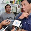 Policeman Leonardo Felonia surrenders to Davao City Mayor Rodrigo Duterte