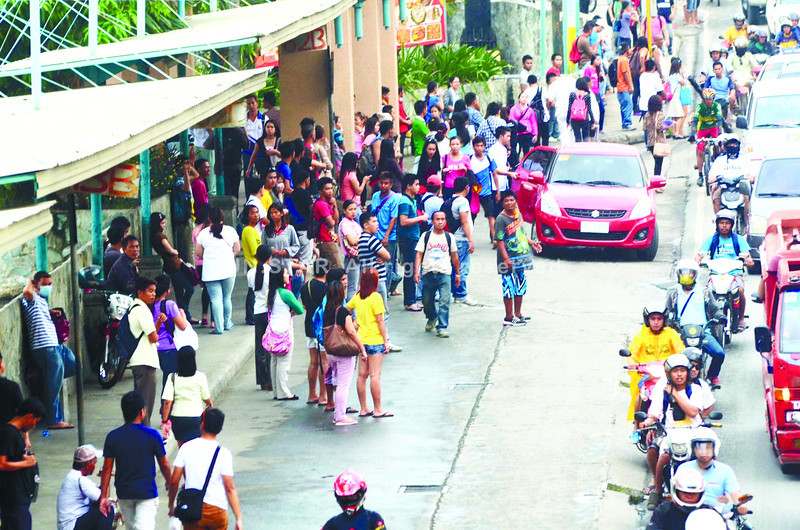 CEBU. Commuters wait for hours for the public utility jeepneys that never arrive because their drivers have abandoned their routes to join a picket and a march. (Ruel Rosillo/Sun.Star Cebu photo)