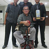 ZAMBOANGA. Isaac Elumba (right) takes time out during the awarding ceremony Sunday evening for a photo session together with fellow golfer Engineer Faizal Hasiman (center), his brother-golfer Eldon (left) and father-coach Judge Eric. (Bong Garcia)